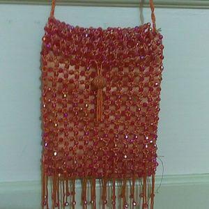 Bijoux Terner orange beaded evening bag